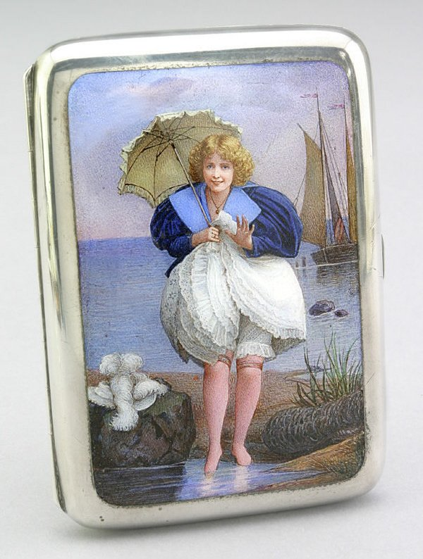 14: A Victorian silver and enamel card case, one side