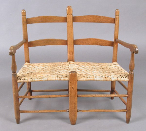 17: An American ox cart seat with arched horizontal