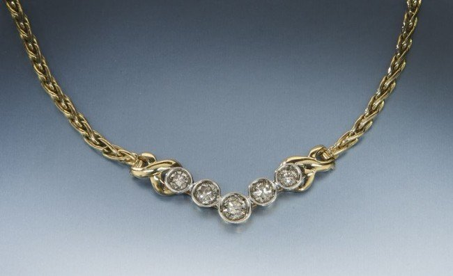 19: 14K gold and diamond necklace,