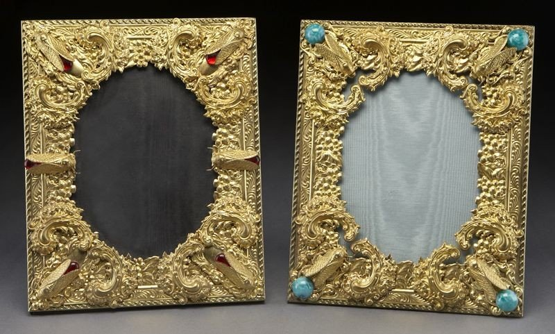 15: Pr. Gilt metal frames featuring floral scrolls