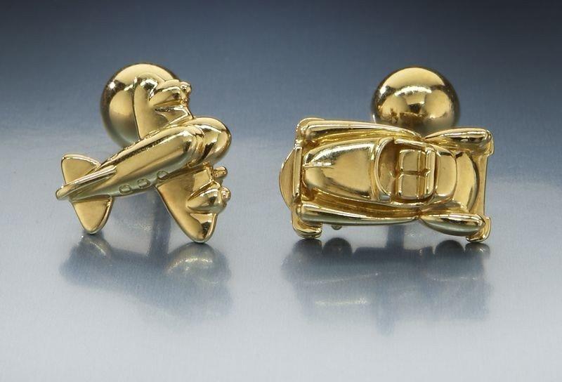 18: Pr. Cartier 18K gold air and land cuff links