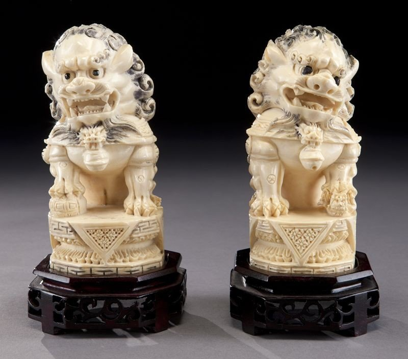 8: Pr. Chinese carved ivory foo dogs,
