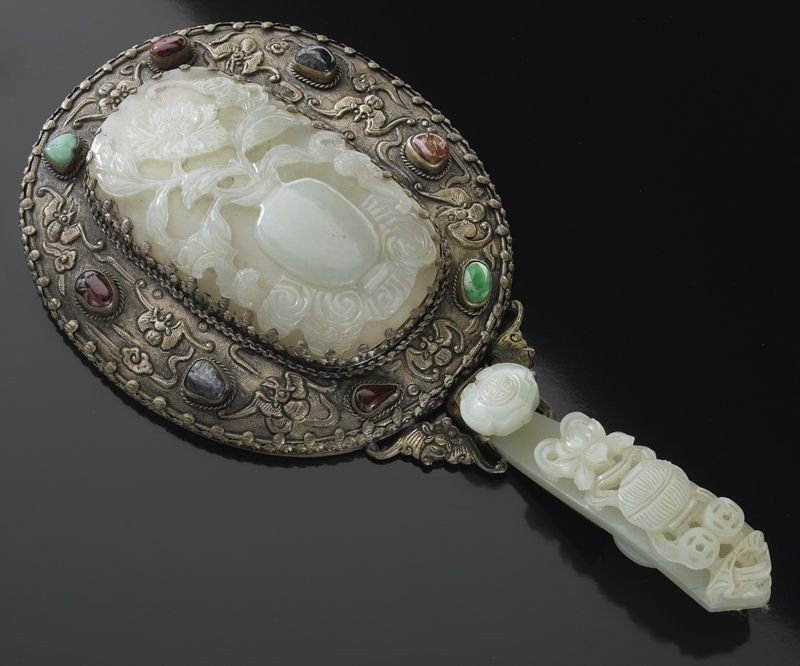543: Chinese Qing silver mounted jade mirror.