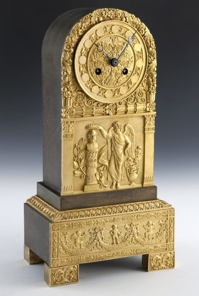 19: Empire style gilt bronze and wood clock,