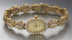 43 Geneve ladies 14K gold and diamond wrist watch
