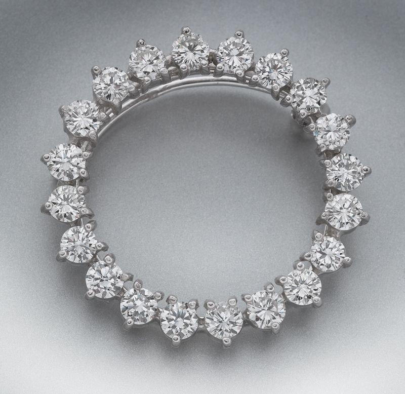 10: Platinum and diamond circular brooch