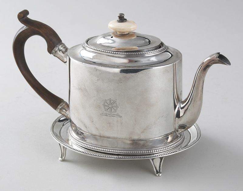 13: Hester Bateman sterling silver teapot on stand.