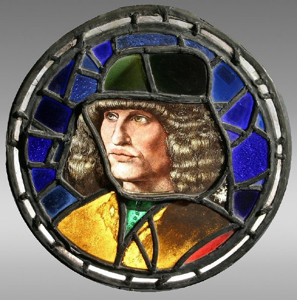 1: A stained glass medallion the center having a man's