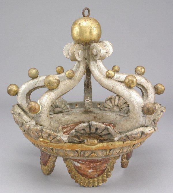 3: A carved Italian gilt polychrome crown shaped