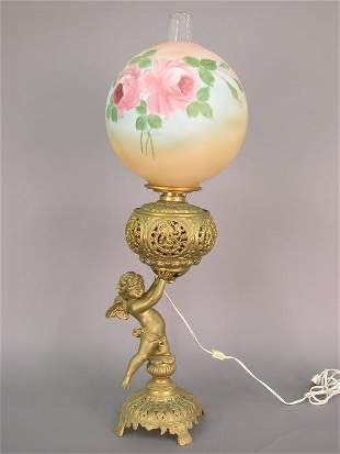 Winged cherub base oil lamp, electrified,