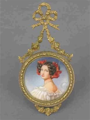 Miniature portrait in a gilt bronze frame