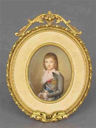 A miniature portrait in a gilt bronze and