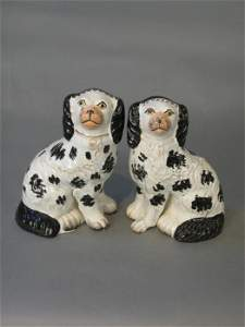 73: Pair of black and white Staffordshire dog