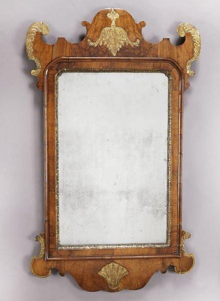 25: Georgian parcel gilt walnut framed wall mirror.