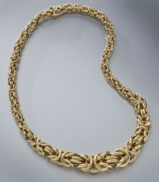 31: Italian 14K yellow gold rope necklace.