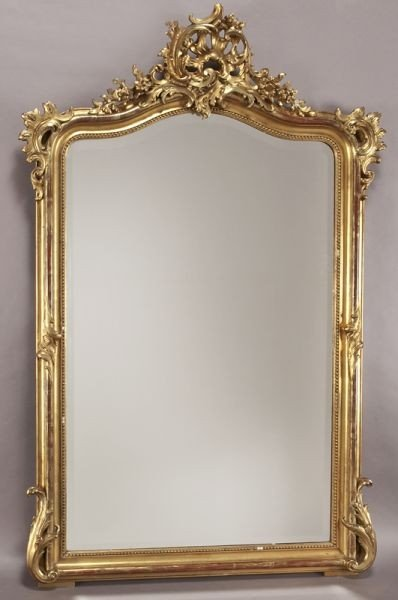 35: Louis XV style carved gilt mirror