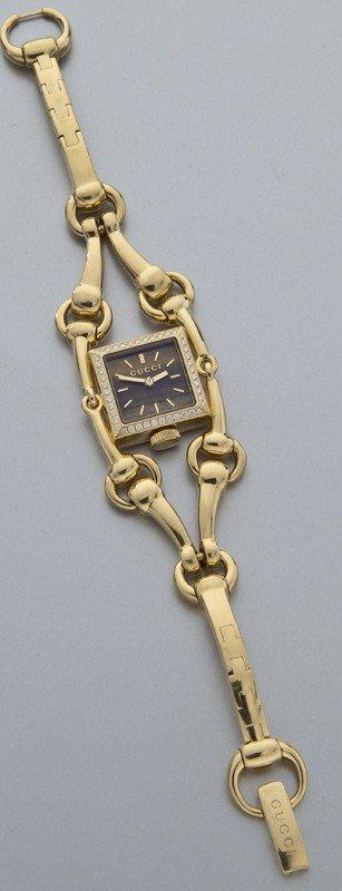 37: Gucci 18K gold and diamond watch,