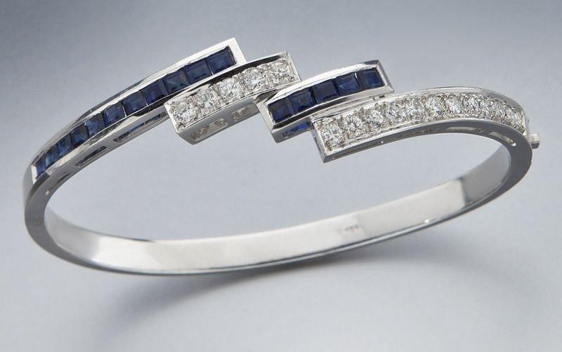 43: 14K gold, diamond and sapphire bangle bracelet