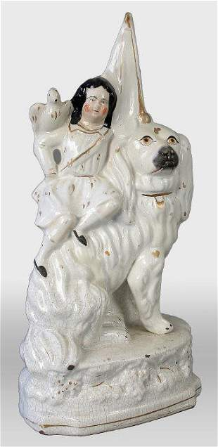 Staffordshire child and dog figural. 13