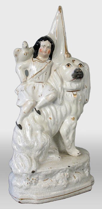 502: Staffordshire child and dog figural. 13