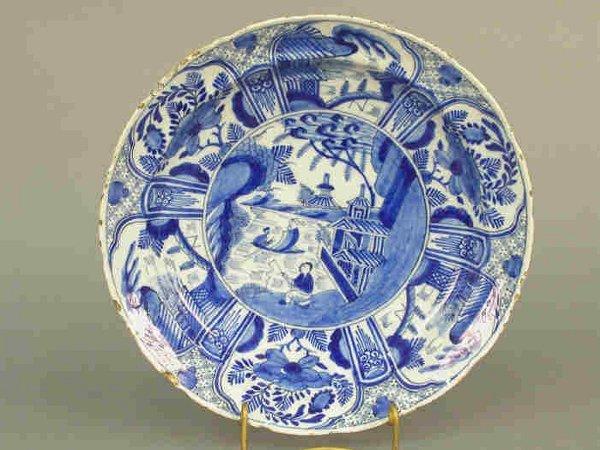 504: Delft dish with Oriental scene in blue a