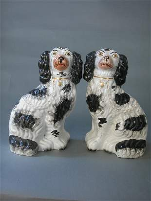 Pair of black and white Staffordshire do