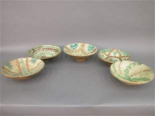 Five French pottery bowls, all worn from