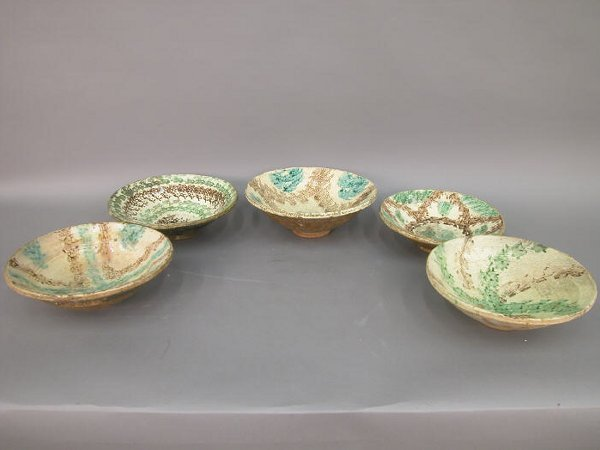 511: Five French pottery bowls, all worn from