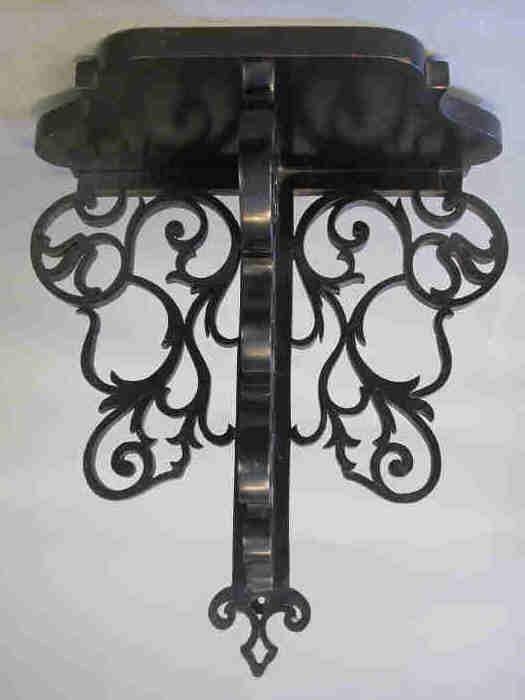 518: English ebonized wood wall bracket. Some