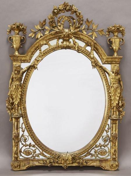 22: Louis XVI style carved gilt mirror surmounted by