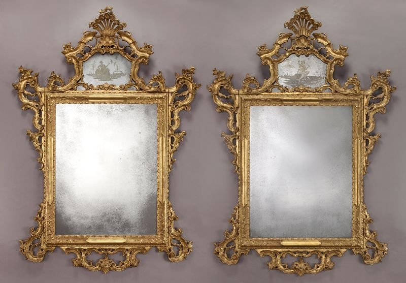 128: Pr. Venetian carved gilt and etched glass mirrors,