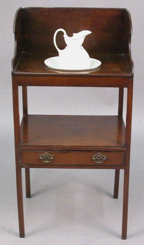16: An English mahogany washstand with shaped back