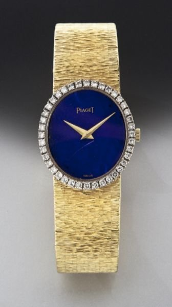22: Piaget 18K gold, diamond and lapis wristwatch