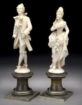19: Pr. French carved ivory figures modeled as a lady