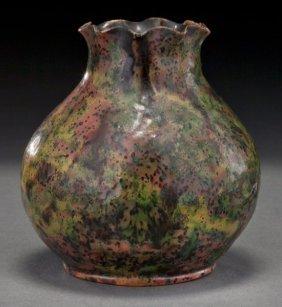 22: George Ohr glazed ceramic vase with a ruffled rim,