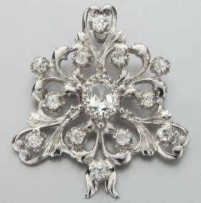 23: 14K gold and diamond pendant / brooch conversion