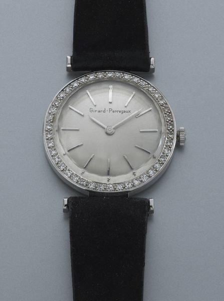 4: 14K gold and diamond Girard-Perregaux watch,