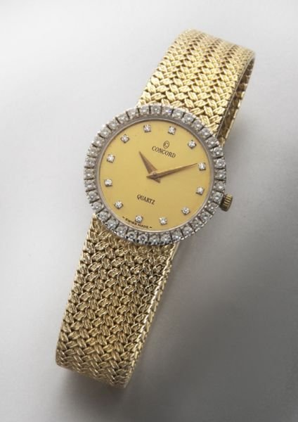 12: Ladies Concord 14K gold and diamond wrist watch