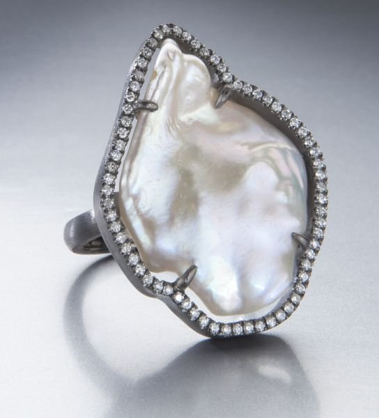 21: Sterling silver, diamond and pearl ring.