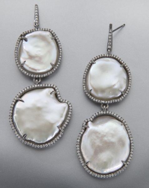 23: Pr. sterling silver, diamond and pearl earrings.