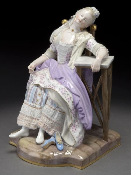 24: Meissen porcelain figure of a seated lady