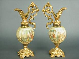 Pair of ormolu and painted glass ewers