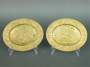 Pair of oval ormolu repousse plaques i