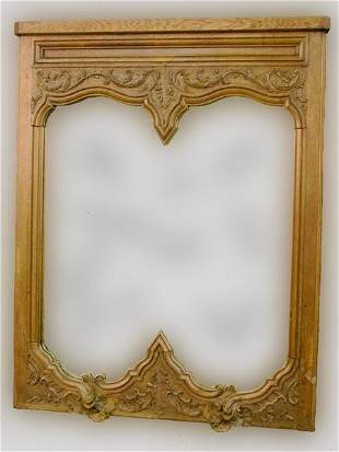 Large wall mirror in carved wood frame