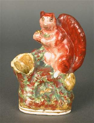 Staffordshire spill vase figure of a sq