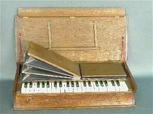 Portable Victorian pump organ in book s