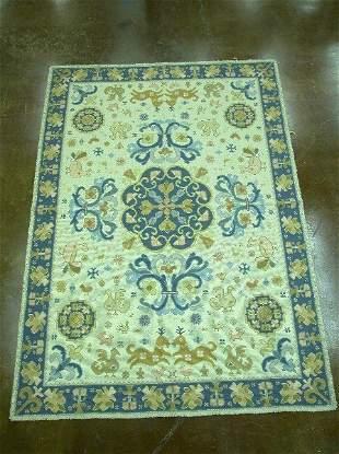 Cream background rug with blue border,