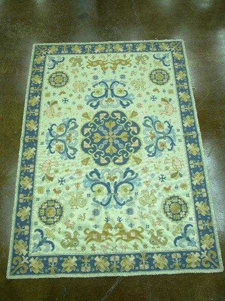 2317B: Cream background rug with blue border,