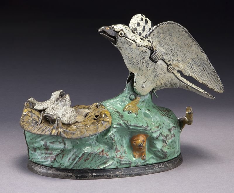 Cast iron Eagle and Eaglets mechanical bank,