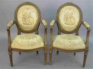 Pair Louis XVI style walnut arm chairs